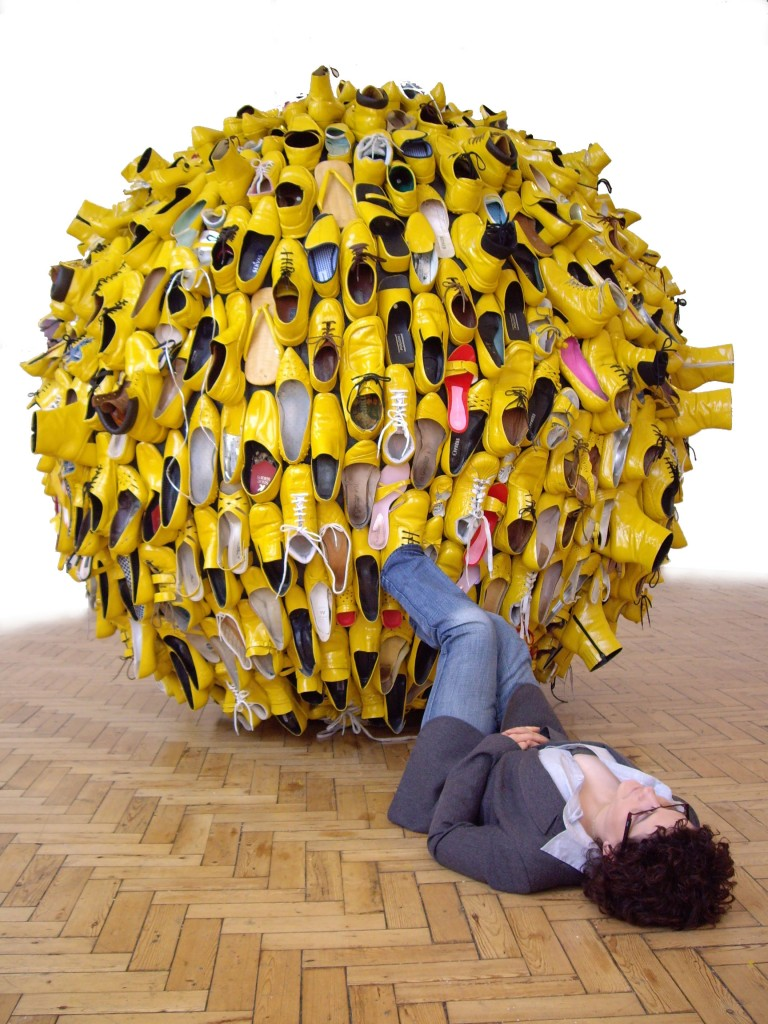 Experiment in Happiness by Nöemi Lakmaier, a site responsive installation made from yellow shoes