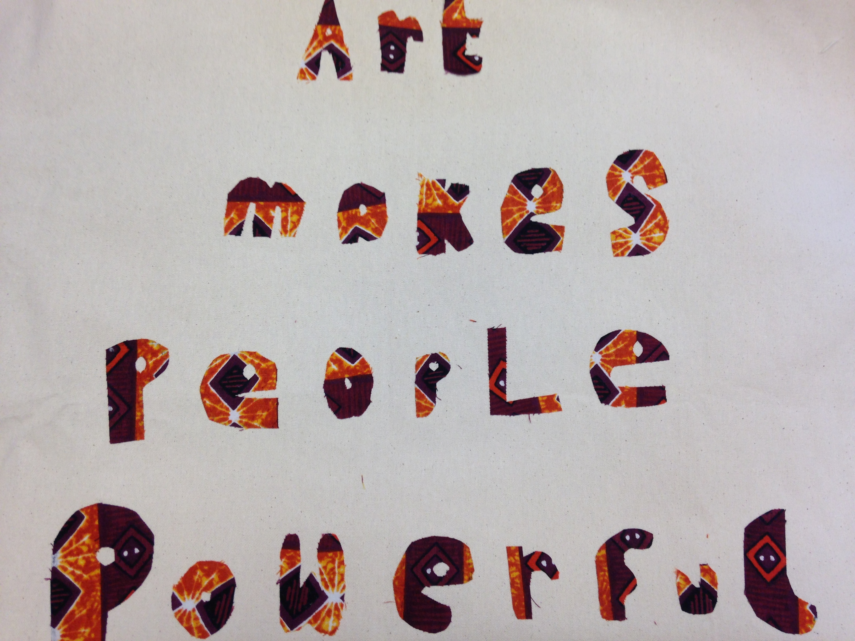 applique work saying 'Art makes people powerful'