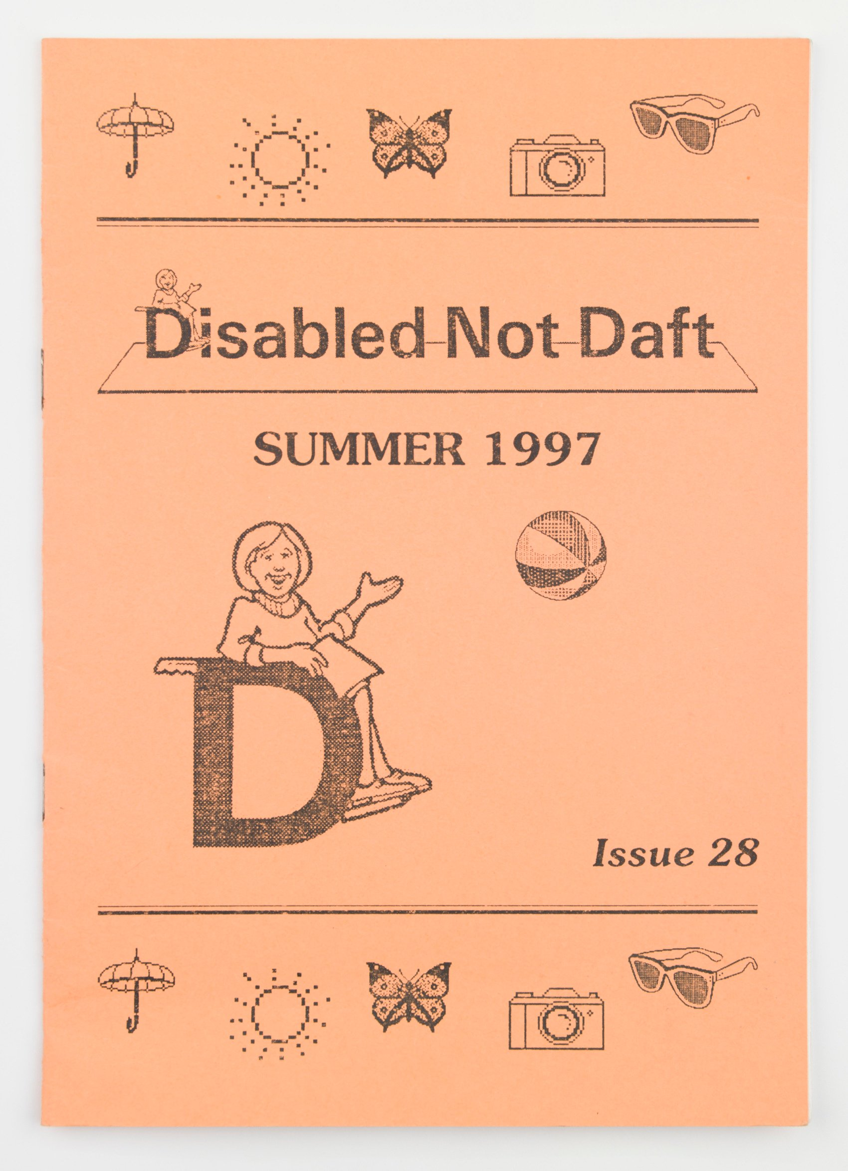 "an old pamphlet cover printed on peach coloured paper. The pamphlet title reads: ""Disabled Not Daft"" and shows an illustration of a wheelchair user."