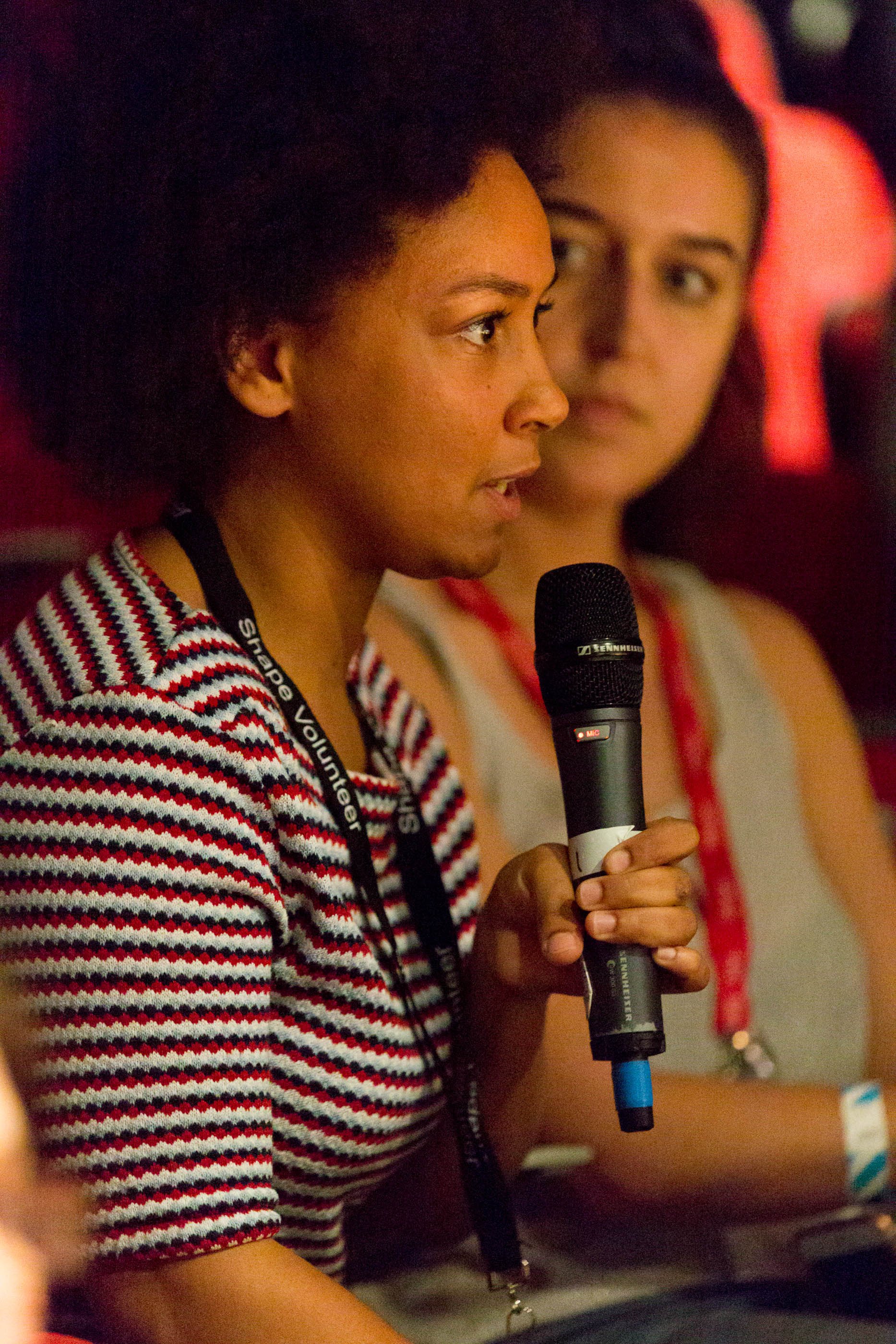 young audience member taking part in a panel discussion