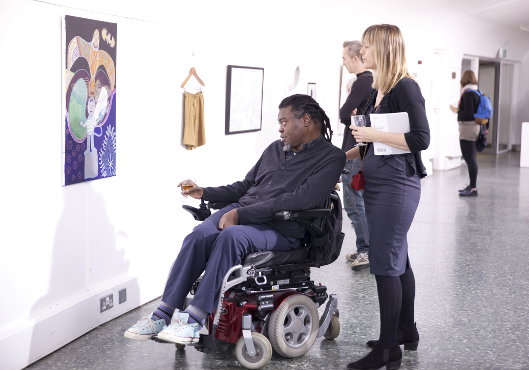 Yinka Shonibare MBE looking at the winning artwork piece in the white gallery space