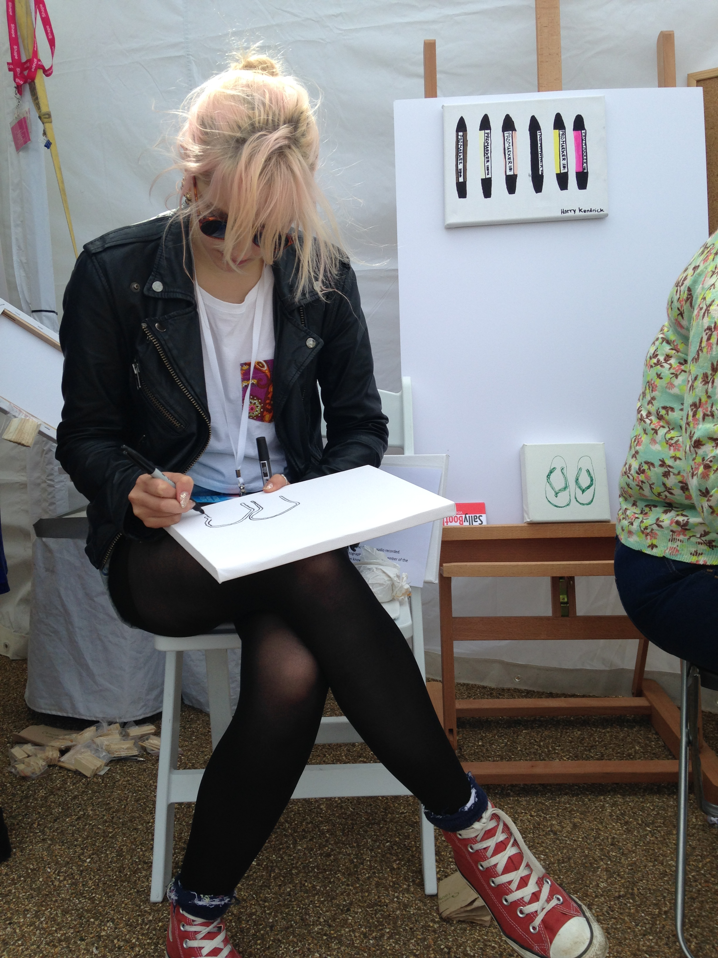 Photo of a female drawing at Liberty festival