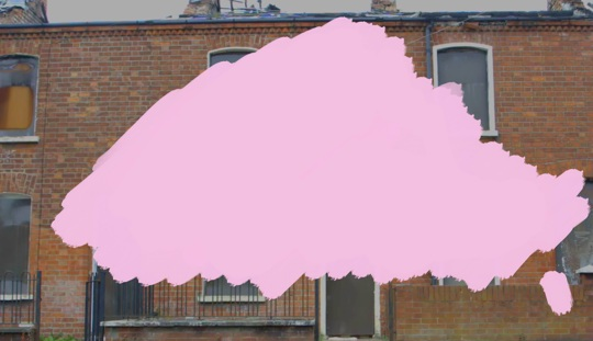 A pink splodge painted on top of a photograph of red brick terraced houses
