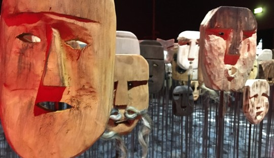 wooden masks carved as a face