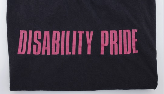 Disability Pride slogan on a fabric material