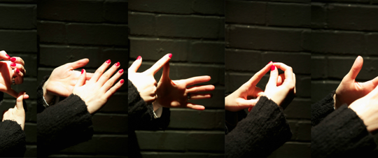 composite image of two hands doing British Sign Language finger spelling
