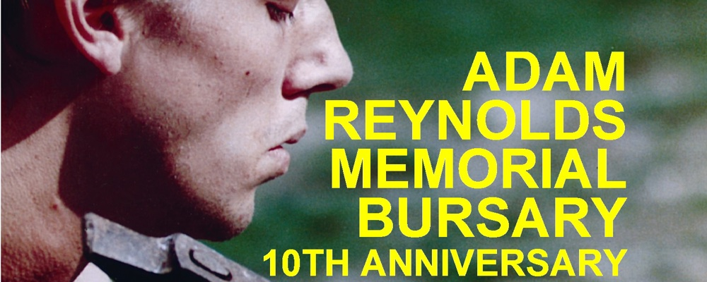 Adam Reynolds Memorial Bursary 10th Aniversary in text next to picture of Adam Reynolds