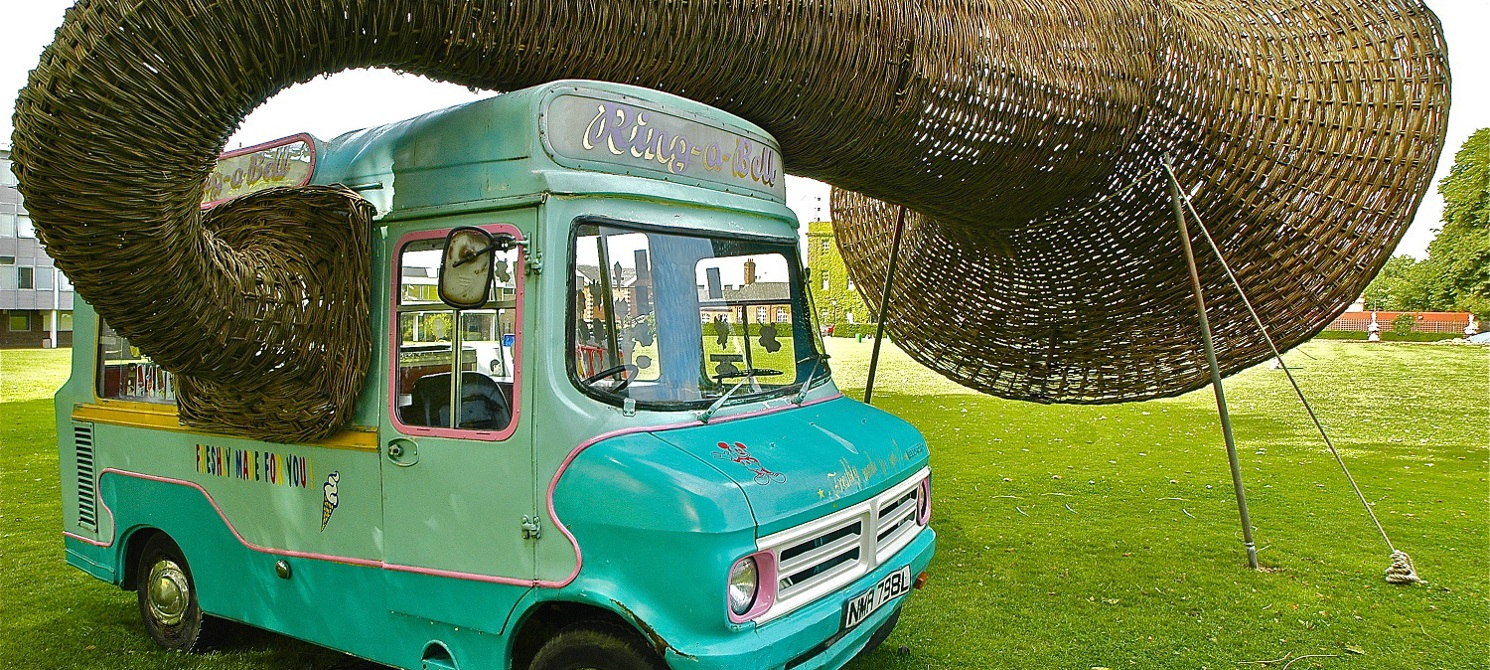 ice cream van has a massive wicker gramophone speaker coming out the window of the van and round