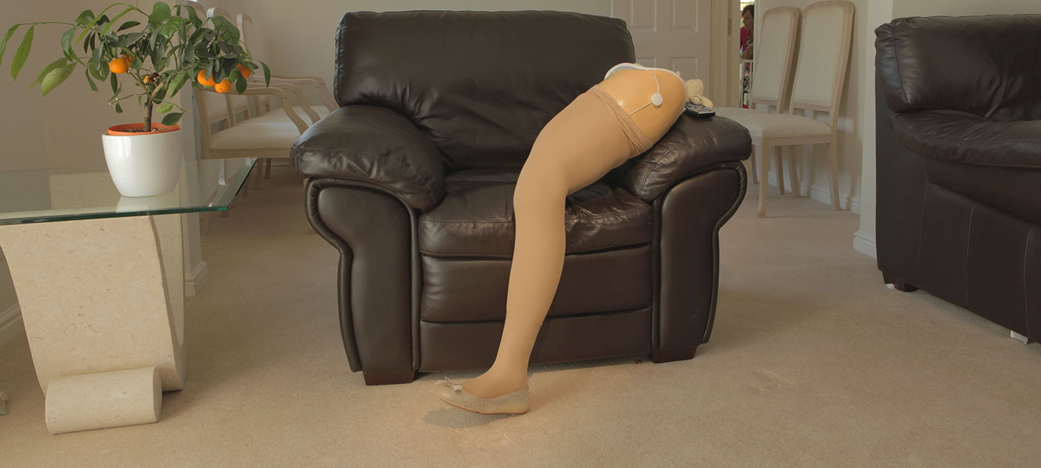 Image of a prosthetic leg positioned on a sofa in an elegant living room