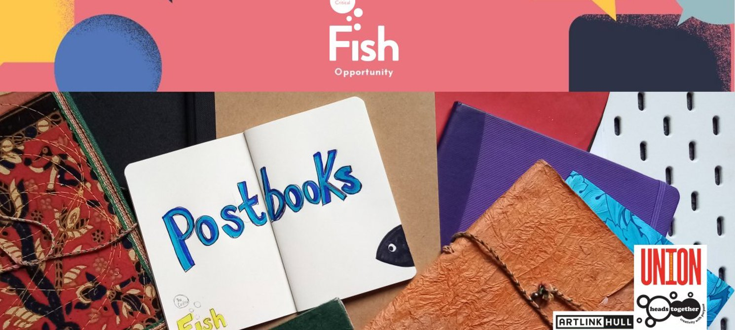 A graphic and photograph. The text at the top reads The Critical Fish. Beneath this colourful, geometric banner is a photo looking down at a table atop of which several notebooks are sprawled across. One notebook is open and across the two pages visi