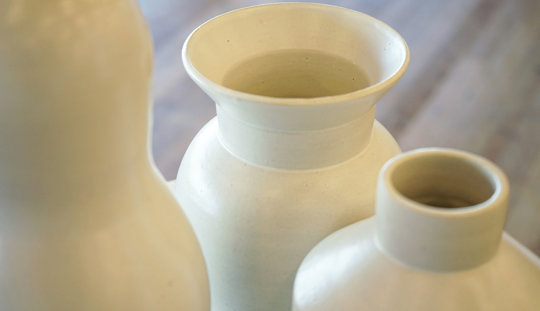 Close up of three ceramic vases, audio was broadcast out of the vases